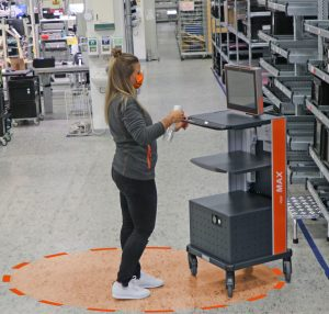 MAX mobile warehouse workstation being disinfected